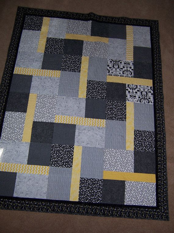 Black and white and yellow quilt