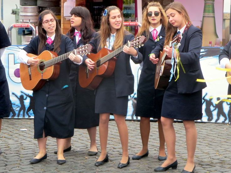 The Tuna Com Elas, a student band from the Associação Académica da Universidade dos Açores (AAUA), performing at a street fair in Ponta Delgada on Sao Miguel Island, Azores.