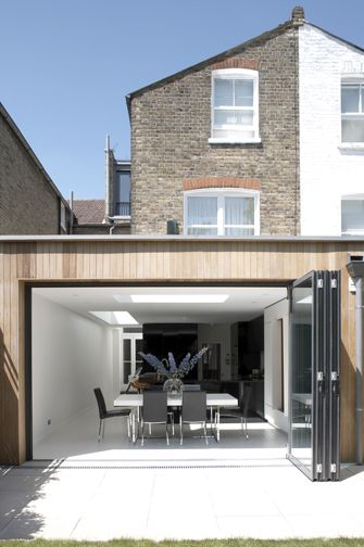 Simple minimal contemporary house extension with opening glass wall | architects: Giles Pike
