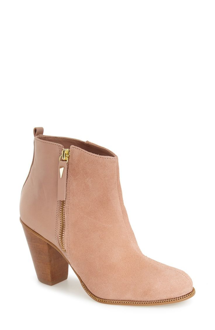 Goldtone trimadds modern edge to this versatile, pale pink ankle bootie.