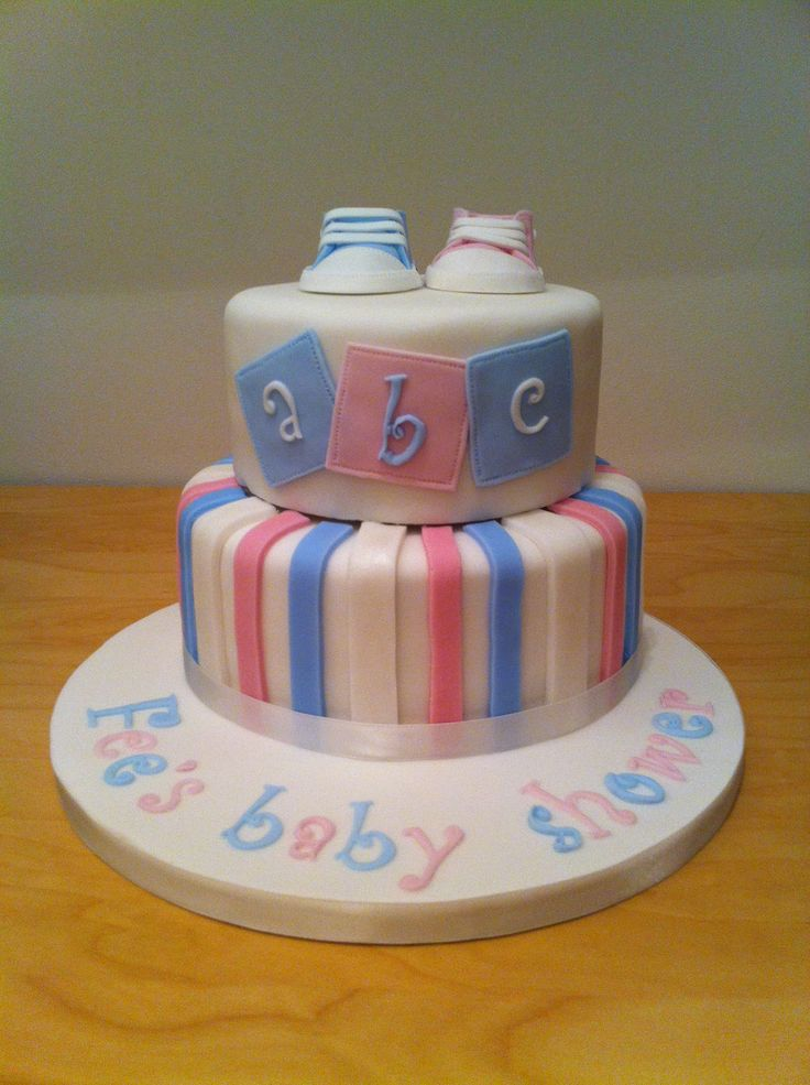 Two tiered baby shower cake with converse booties