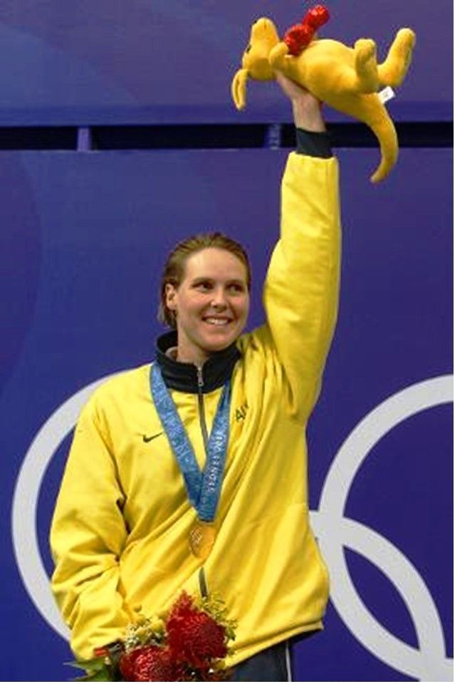 Swimmer Susie O'Neill of Australia, with a kangaroo mascot, wears her gold medal after winning the Women's 200 metre freestyle final.