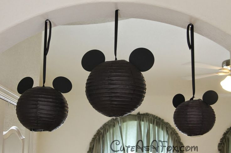 Take ordinary black paper lanterns.  Use glue dots to put black circles on the sides of black lanterns.  For Halloween, you could add a jack-o-lantern face!