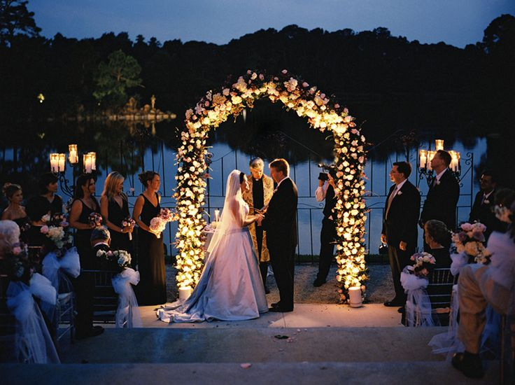 Love everything about this the roses on the arch, the bows on the chairs, the smiles on everybody's faces:)...... Love it