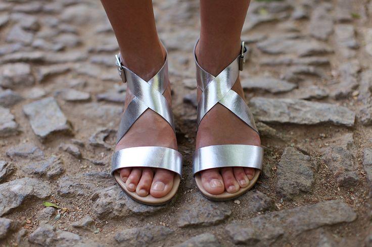 metallic silver sandals.