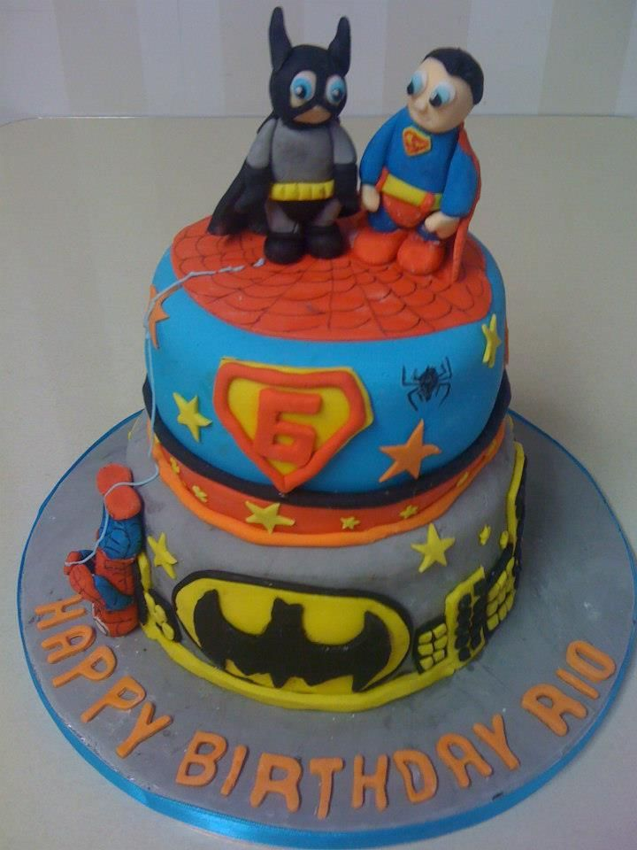 2 tier superhero cake. Batman and Superman characters.
