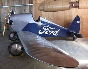 """The Ford Trimotor was Henry Ford's first successful commercial aircraft venture in 1925. Following the Ford Model T as an """"everyman's"""" vehicle, the Ford Flivver was designed to be a mass-produced """"everyman's"""" aircraft.[2] The idea was first proposed to William Bushnell Stout, manager of Ford's acquired aircraft division in 1926. Both Stout and William Benson Mayo, head of Ford's Aircraft Division wanted nothing to do with the aircraft and it was built in a nearby museum building in th"""
