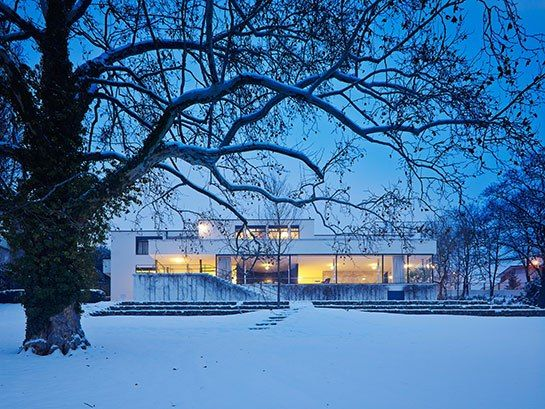 Tugendhat House in the snow and twilight