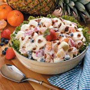 ~Favorite Marshmallow Fruit Salad~ The cooked custard dressing for this salad is uniquely delicious. Mixing in marshmallow halves with the fruit makes each serving light, fluffy and fun! -
