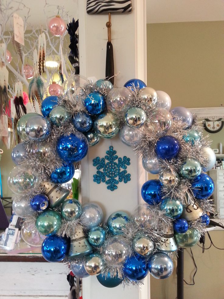 vintage ornament wreath. blue silver white with center blue snowflake to hang freely. silver tinsel for filler. shiny brite bells. mercury ornaments tiffany blue ornaments christmas wreath diy