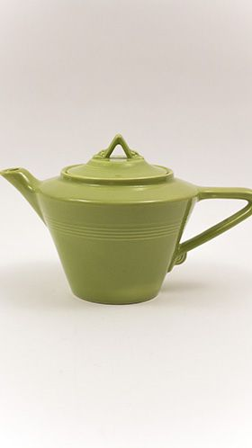 Homer Laughlin Pottery's Harlequin line teapot in original 1950s chartreuse [lime green] glaze, tapering body and angular triangle shape handle and knob, c. 1950-1959, USA ... Harlequin line created exclusively for F. W. Woolworth's five and dime department stores, sold late 1936-1965