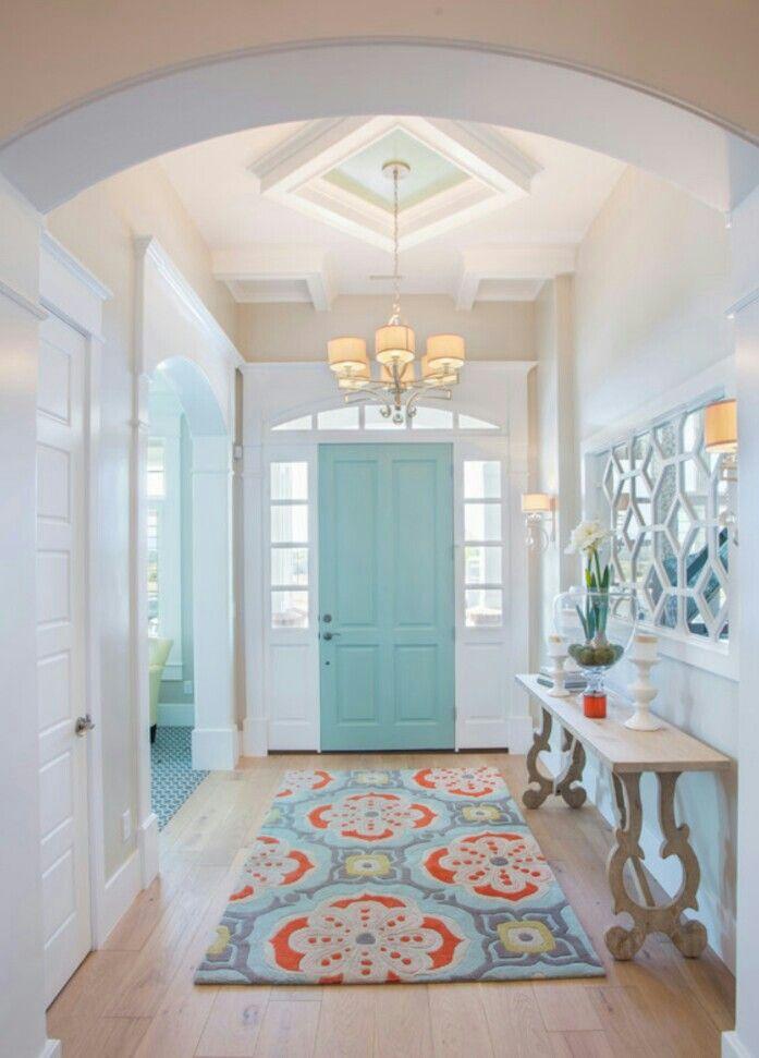 Robins egg interior door offsets crisp white woodwork.