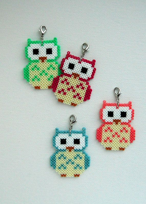 You are choosing between four different colors on this Owl pendant made out of Hama mini beads. Perfect to wear around your neck or use in your home