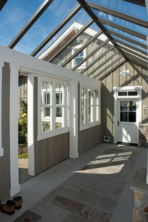 using a greenhouse as a connector between the main house and a garage or guest house is a great use of space