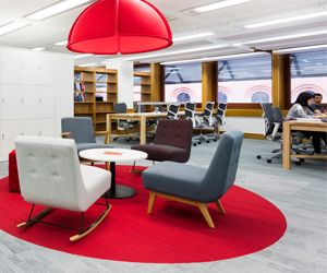 Red Office Design >> Colour in Interior Design >> Red is proven to stimulate cognitive activity. A red office interior can boost energy levels and cognitive ability by increasing blood flow to the brain. At The Alan Turing Institute we used red carpets and red lamp pendants as a directional colour to highlight areas for collaborative work, and informal gathering spaces. Red is complemented by neutral tones, such as grey, white and black, to balance out the effect.