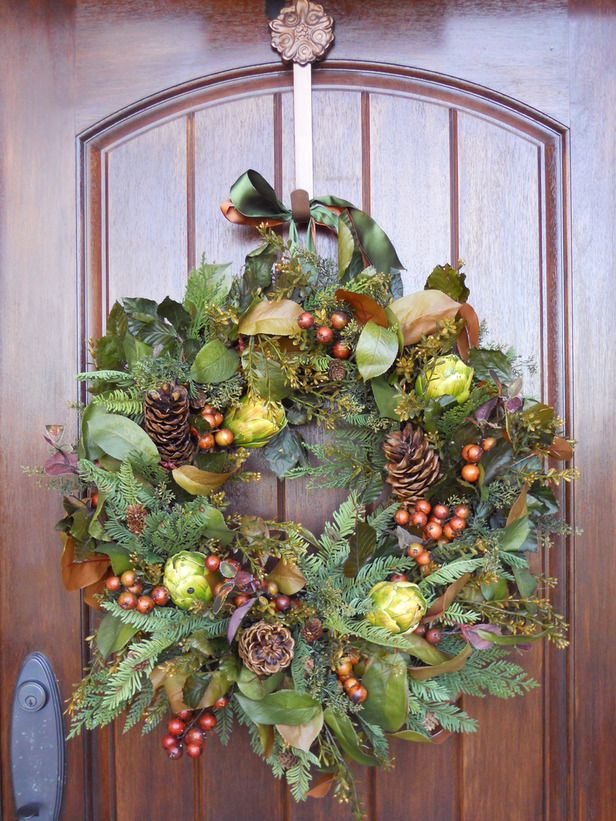 Bountiful Fall Wreath    Materials and Tools:  18-inch grapevine wreath base,    3 or more large pinecones , 3-5 faux artichokes, various faux pine sprigs,    faux magnolia leaves, faux berries, faux seeded eucalyptus bush, hot glue and glue sticks, florist wire, wire snips,    autumnal-colored ribbon, moss