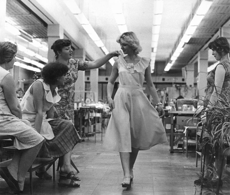 Soviet women trying on a dress they just sewed (early 1970s)