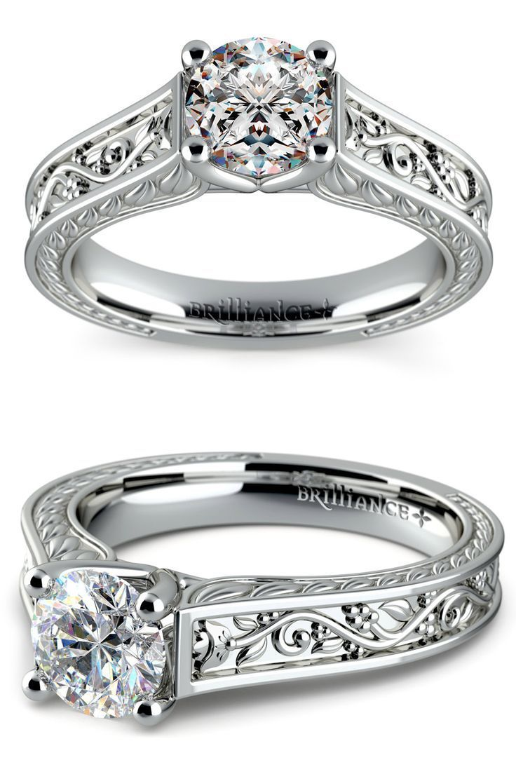 This intricate white gold solitaire engagement ring features antique floral d