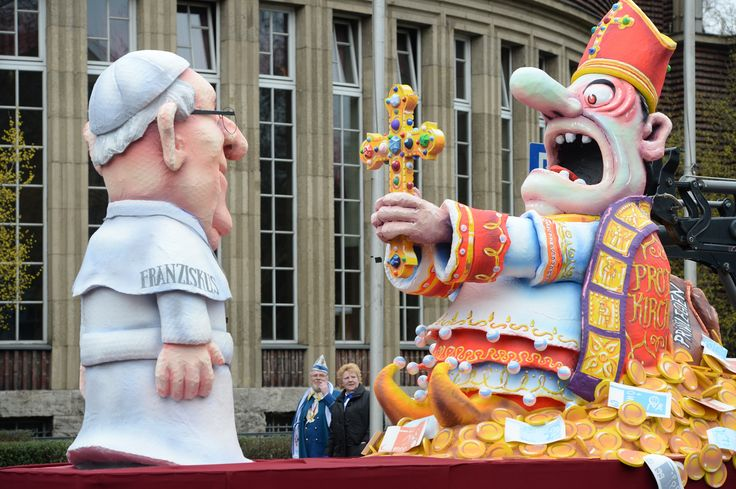 Pope Francis vs. 'Bishop Of Bling' Smackdown On German Carnival ... German Carnivals promoting hate/war mongering for the whole world. And the spectators love it! Wait..?  Weren't the Germans the ones who started WWI and WWII?  What are they trying to tell us now?