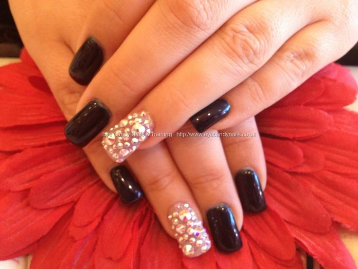 Acrylic nails with midnight satin gel polish and Swarovski crystals on ring finger