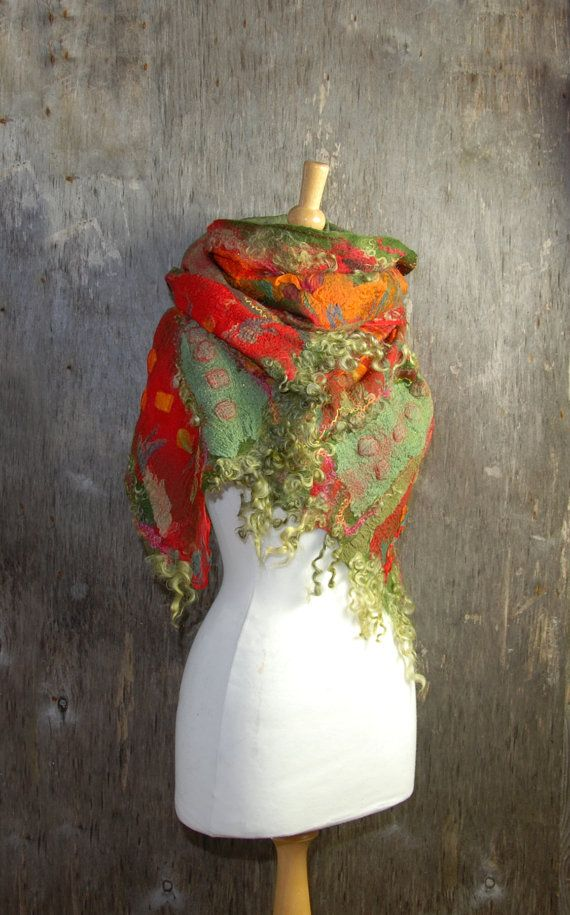 Felted scarf Nuno felted scarf Felt shawl merino wool chiffon silk green red orange olive green felted art winter wool scarf scarf Beautiful and unique felt scarf I have made it from australian merino wool , silk fabric, wool locks, Angelina Fibre and tussah silk-wet felting technique Dimensions length-74(188cm) width-18,5(47cm) How to wash Simply hand wash in a gentle soap or hair shampoo (lukewarm water). To dry, lay the scarf on a flat surface. Set iron for wool and use stea...