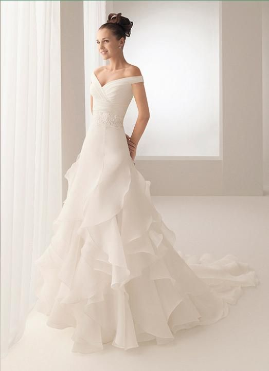 ruffly off the shoulder wedding dress; not sure what you think of the flowy bottom, but off the shoulder yay!