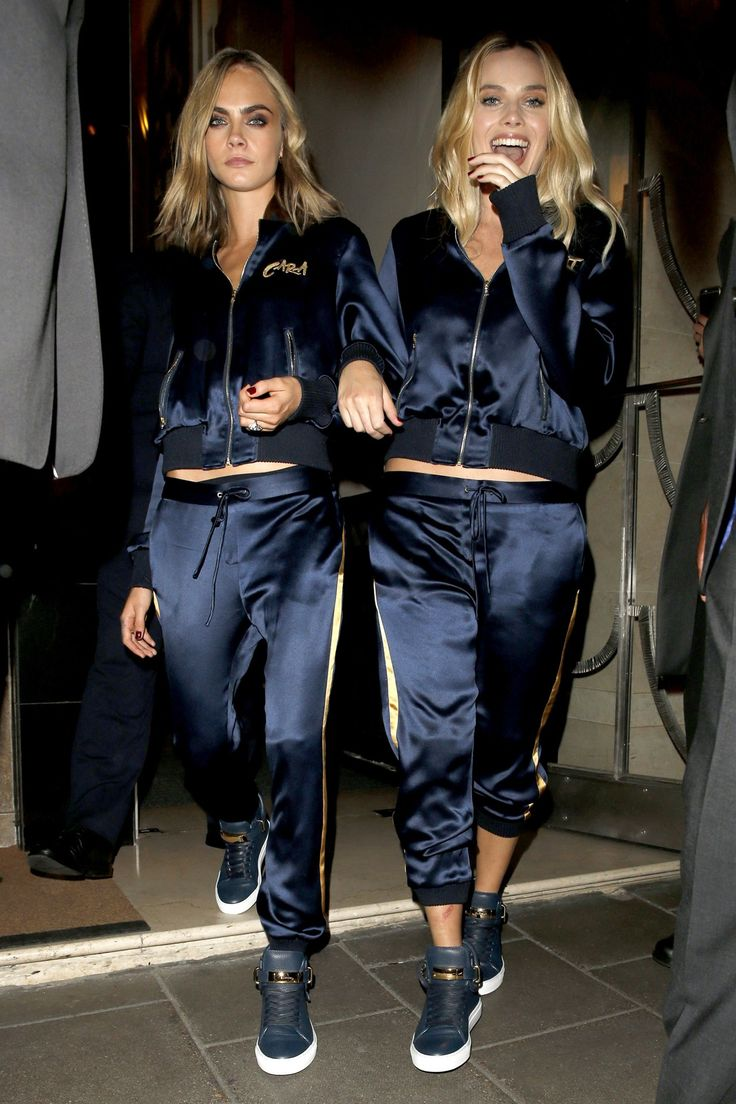 Cara Delevinge & Margot Robbie in matching personalised tracksuits
