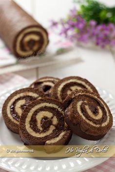 Girelle al cioccolato tipo merendine Motta nate da un rotolo bicolore. Un dolce morbido e facili da preparare, con tanta cioccolata e Nutella ideale per merenda.