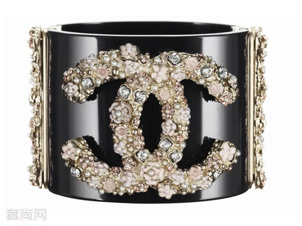 Chanel cuff. Somewhat logo-maniacal but fun.