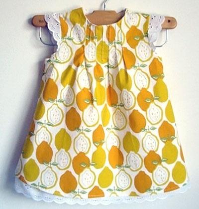 Dress:  Marissa Fischer Lemonade Dress with Ruffled Bloomers from The Baby Gardner $48