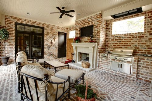 This patio almost looks like an outdoor bricked living room. This setup is unique because it is virtually all made of brick. You can't even really tell where the floors and the walls begin since that same type of brick is used all throughout this scene. This is a great way to use that traditional brick work into a more contemporary scene that will leave guests under the impression you know how to really decorate a room. It's elegant and completely unique.