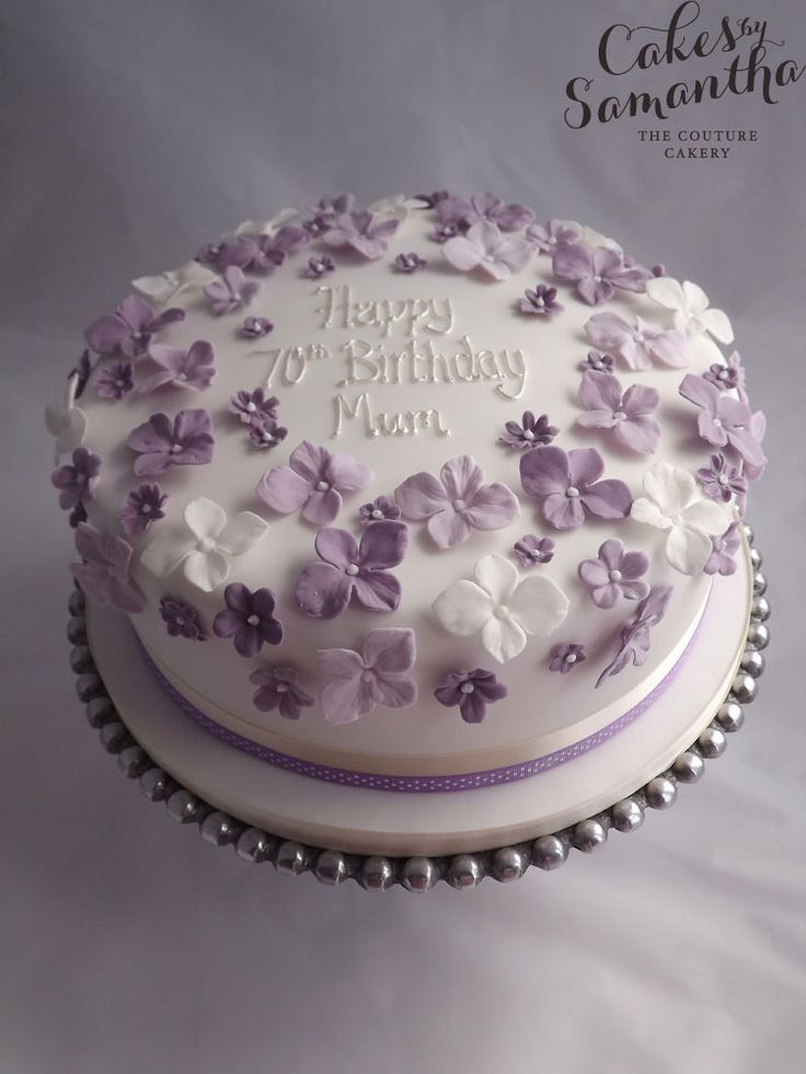 70th Birthday cake with purple flowers.