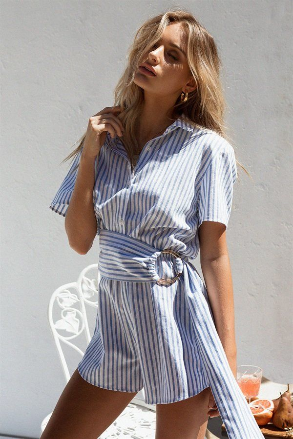 Be bold in the Stipe Camryn Playsuit, made from a white cotton fabric with blue stripes throughout. It features short sleeves, collar, buttons up centre front and matching belt with gold ring detailing. Complete the look with the Martina Tube Hoops! By Sabo Skirt.