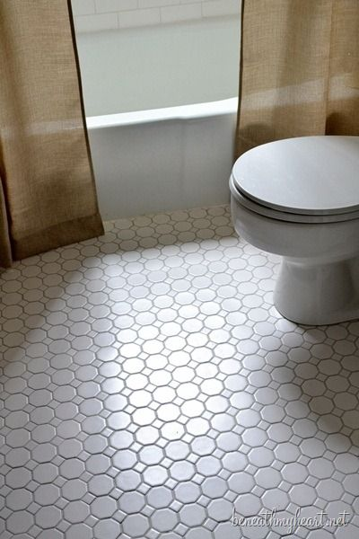 white octagonal tile flooring   Perfect for the basement bathroom. I bought them at Lowe's for $2.57/sq.ft.