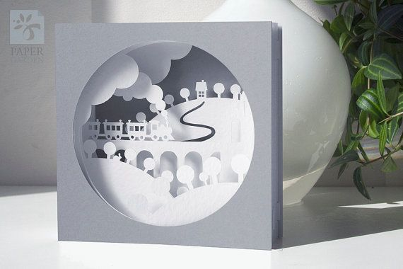 Printable PDF papercutting template of 3d pop-up card. Card design is the scene with the train, trees and small rabbit. It consists four inner layers and two parts of cover.  The front dimensions: 12x12 cm (4.7x4.7 inches). The depth of open card is 5 cm (2 inches), but you can shrink it to depth 0,5 cm (0.2 inch) and place it into an envelope.  I recommend printing and cutting on: Cover = 200-250 gsm Inner layers and lateral parts = 150-180 gsm cardstock Have the freedom of choosin...