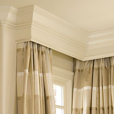 These curtain panels are hung behind a pelmet (also known as a cornice), so the hardware doesn't distract from the elegant fabric. The structured frame, used to enclose the top of a curtain, adds a touch of formality. With this installation, you don't have to worry about what kind of curtain rod to buy; it's hidden from view, so an inexpensive stock one will do. Custom-made pelmets offer a cohesive look when built to match crown molding.