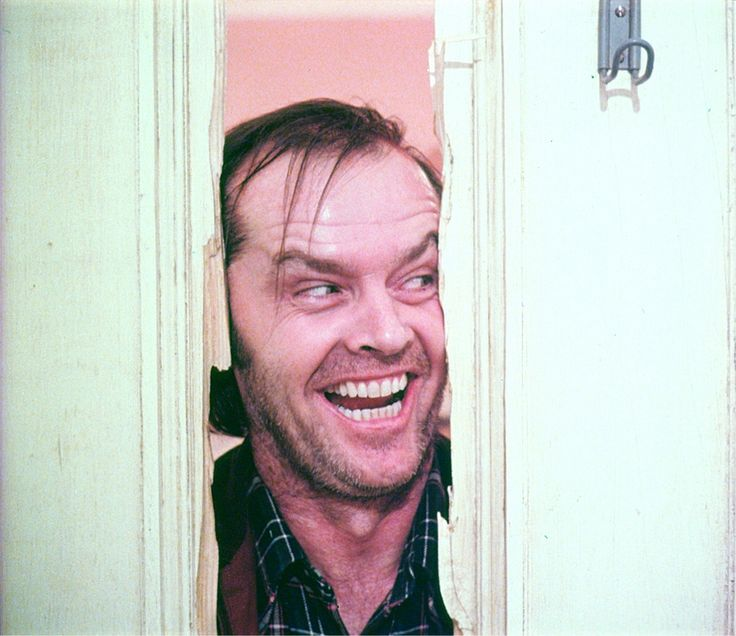 "Frames from an unused takes from 'The Shining,' courtesy of Lee Unkrich's The Overlook Hotel. These alternate takes of Jack Nicholson rising into frame after murdering Dick Hallorann and iconic ""Here's Johnny!"" moment was used in an American television spot for 'The Shining' upon its initial release. A British version of the television spot also exists, and is nearly identical to the U.S. version with the exception of two shots.  The picture below, also courtesy of The Overlook Hotel, ..."