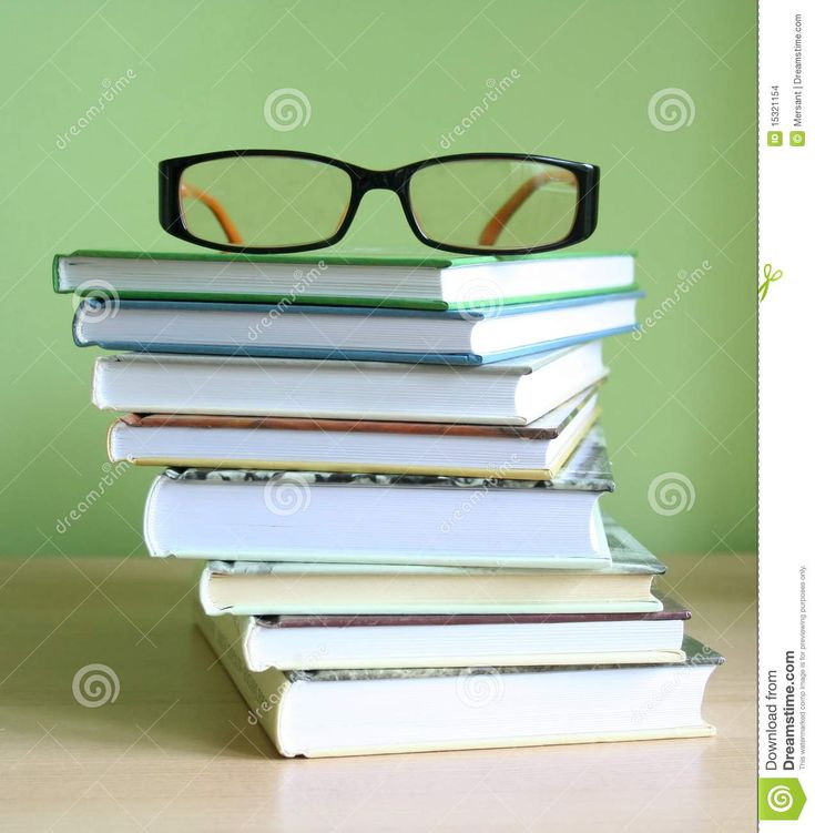 Some books and glasses on a desk