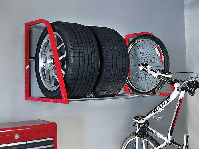 Red Wall Mounted Tire Rack This Red Wall Mounted Tire Rack Is A Great Solution For Storing All Types Of Tires In Your In 2020 Tire Storage Bike Rack Garage Tire Rack