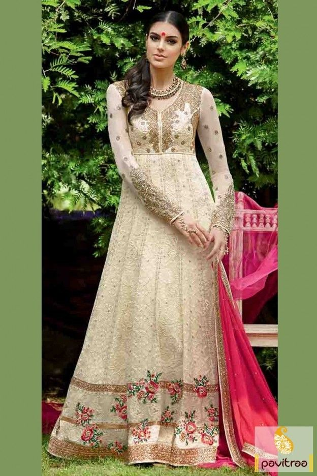 Attractive design with #cream and #pink santoon bridal anarkali suit online portal. It is decked with golden threaded embroidery on full umbrella dress with sleeves.  #anarkalisuits, #anarkalidreses, #dresses, #weddinganarkalisuits,    #designeranarkalidress, #partywearsalwarsuit, #eveningdress, #fashionable  More :  Any Query : Call / WhatsApp : +91-76982-34040
