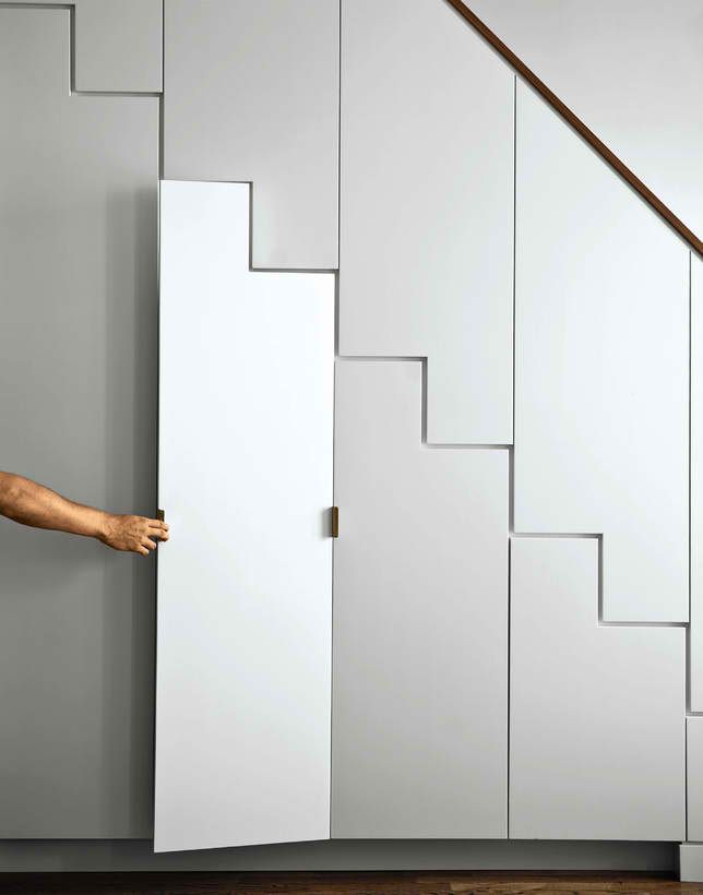 Handy closets under a staircase & the lines are interesting.