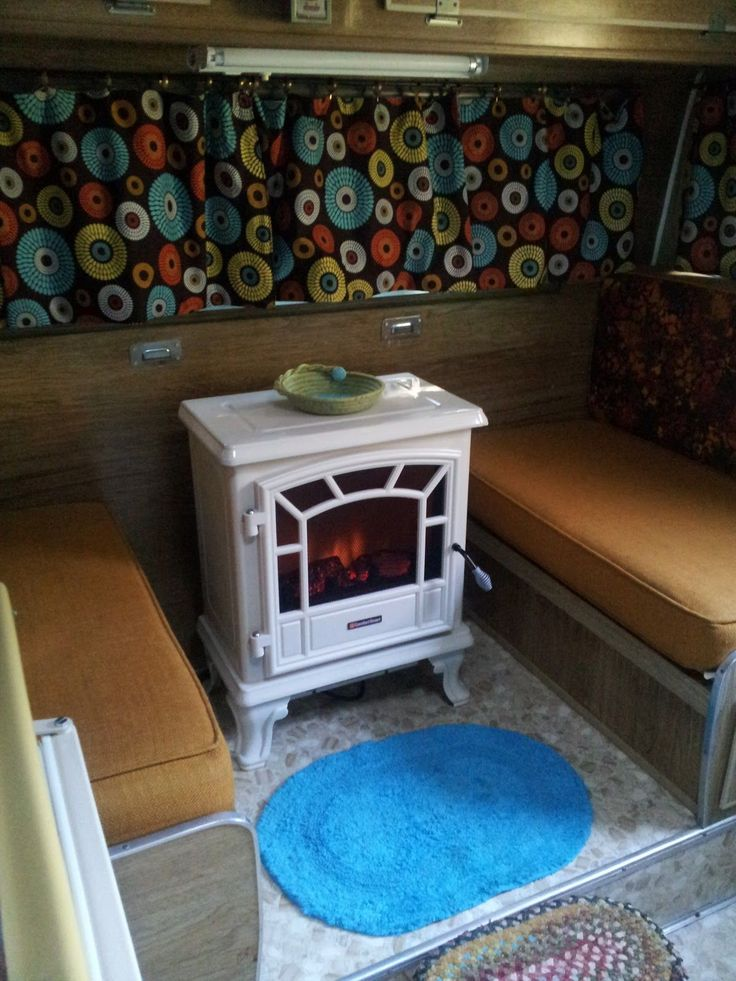 Essential Winter Camping Hacks Electric fireplace. So cozy! Never thought of putting ours there... May have to try it