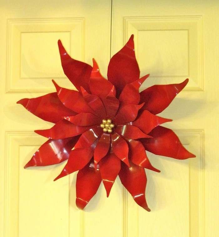 Extra Large Steel Poinsettia, could be made from soda cans and then spray painted.