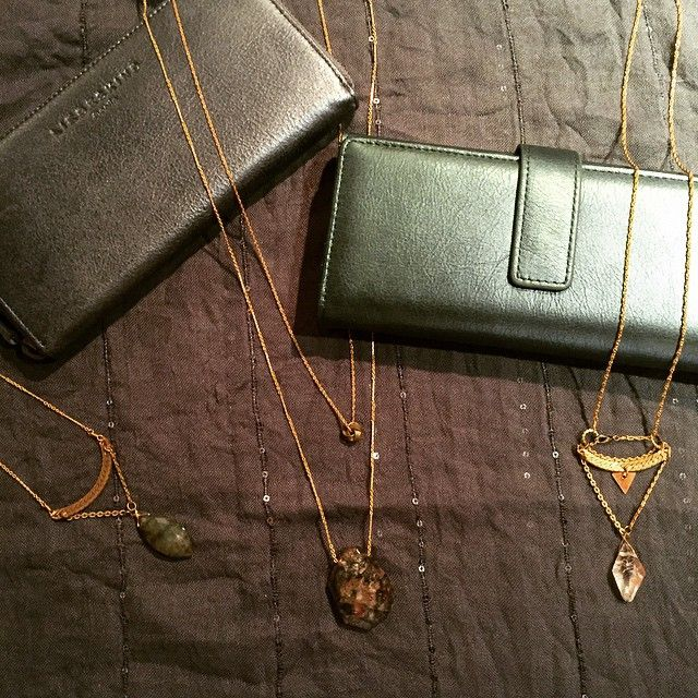 Liebeskind glossy metallic leather wallets and gemstone necklaces