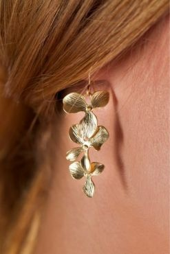 These stunning sterling silver earrings with white gold plated orchids are simple but elegant.    Matching necklace and bracelet available    Also available in Gold. $39