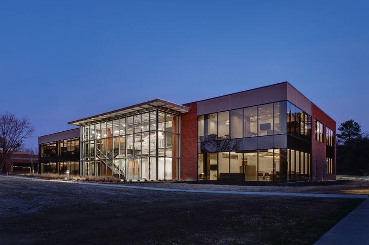 Three Story Brick Building With Glazed Addition Modern