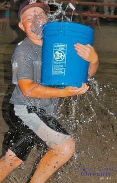 The holey bucket race is a fun water game for a family reunion, birthday party or Summer Olympics party.