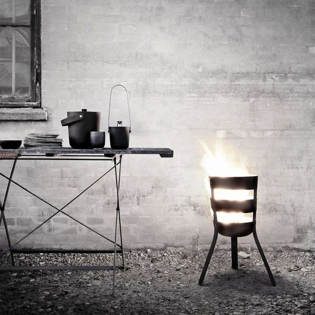 Fire Basket is a new kind of portable outdoor fireplace. Simply fill the oxidized steel basket with firewood and surround it with good times.  Good times indeed.