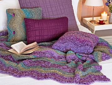 How To Crochet A Stripe Tease Rug: The Stripe tease Rug and Cushions is made in stripes, using 2 strands of yarn worked together. Start each project with the purple Mousse and purple Beauty used as 1 yarn, then green Chantilly and green Beauty for next stripe. Use just the green or purple yarns for plain Cushions.