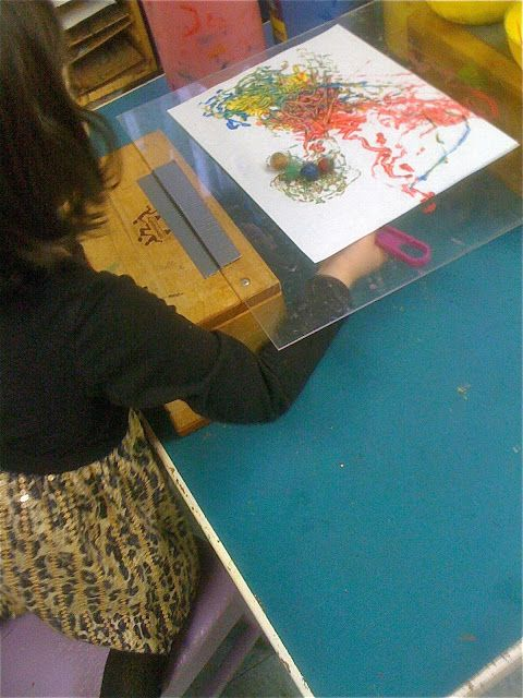 Studying the magic of magnetics with art!  Paint with magnetized marbles and a strong-ish magnet or magnet wand.  :)